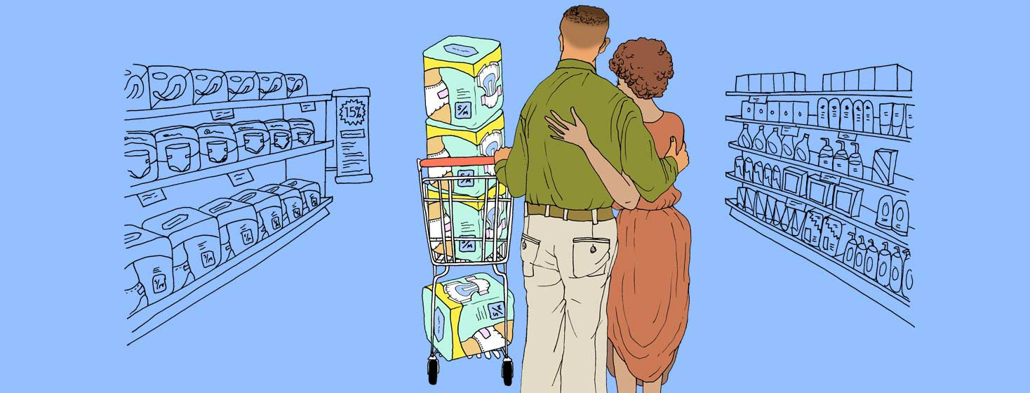 a couple shares a tender embrace as the husband pushes a cart full of adult diapers